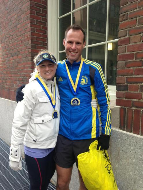 Jessica and Eric minutes after finishing the 2013 Boston Marathon